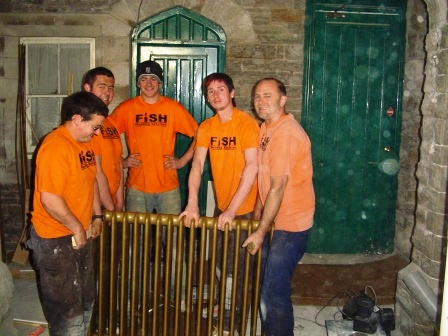 The FISH family of plumbers were employed on ground floor en-suites, shown here installing our original, fully reclaimed radiators