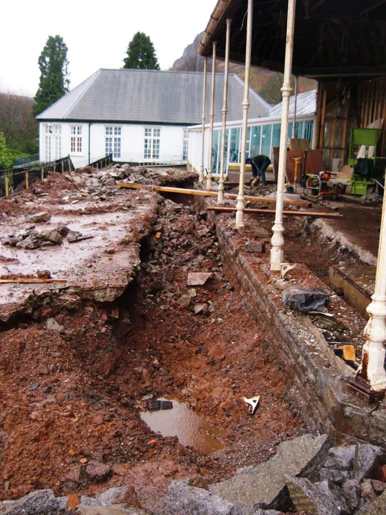 Digging down the terrace, we found the original lost low stone wall that was visible 100 years ago