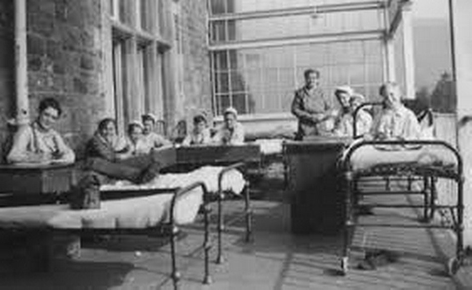 Craig y Nos Castle when it was a TB Hospital with patients on iron framed hospital beds outside for fresh air, on the terraces