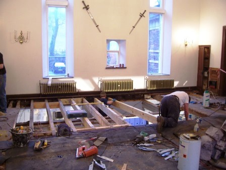 Floor joists in the Billiard Room being replaced because joists had rotten where connect with exterior wall