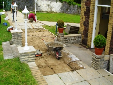 Laying the patio and paths around the side of the theatre at Craig y Nos Castle in Brecon Beacons