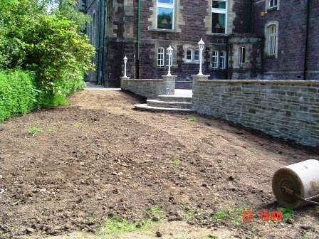 Landscaping and rolling the new gardens following building of new rear of theatre terrace and wall