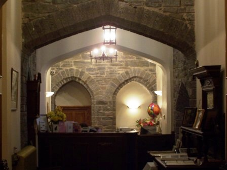 Looking towards reception - note the two arches, each once a separate doorway to the two cellar kitchens