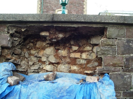 Once water has got inside the stone wall, frozen and expanded in winter, the wall will disintegrate as shown